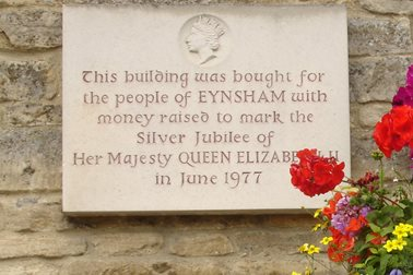Plaque on the east wall - This building was bought for the people of Eynsham with money raised to mark the Silver Jubilee of Her Majesty Queen Elizabeth II in June 1977 - Photographer Eynsham Online