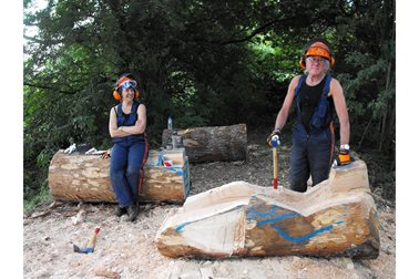 The sculpture beginning to take shape - Godfrey and Amanda carving in situ - Photographer Sue Osborne