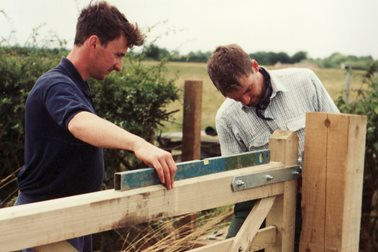 In stile! - Paul O'Hagan and Matt Ball put up stiles along the walk - Photographer Sue Chapman