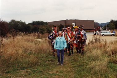 Follow me ... - Sue Chapman leads the Morris Men along the new footpath - Photographer Witney Gazette